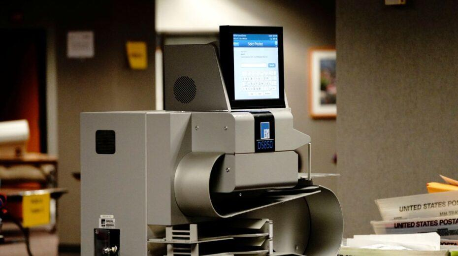 """When Does A """"Glitch"""" Become A Coup? It's Time to Regulate America's Fly-by-Night Voting Machine Monopoly"""